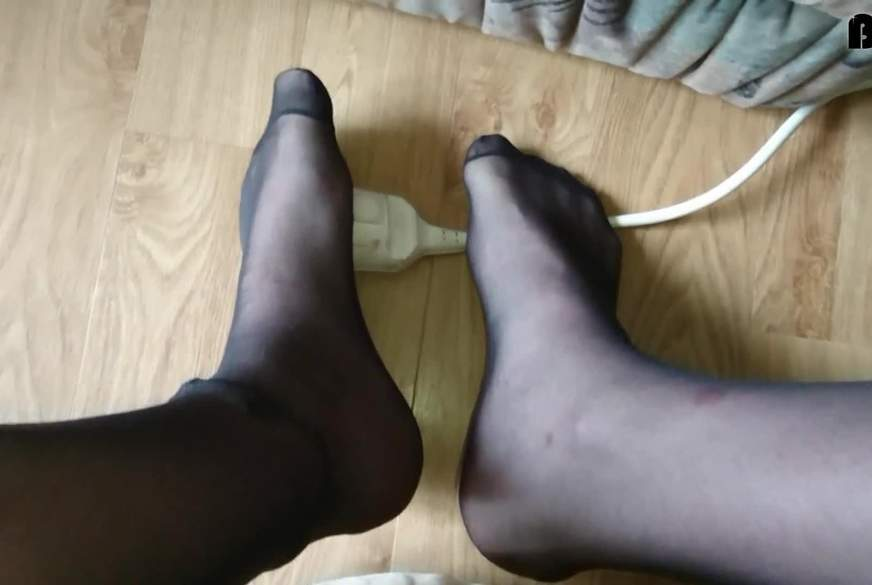 Footplay in Feinstrumpfhose